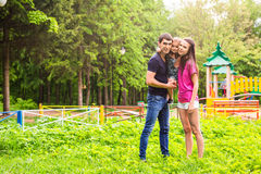 Happy young family spending time outdoor on a summer day stock image