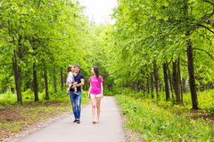 Happy young family spending time outdoor on a summer day stock photography