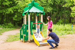 Happy young family spending time outdoor on a summer day royalty free stock photography