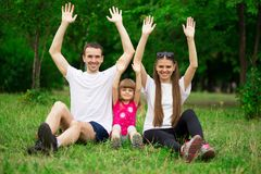 Happy young family spending time outdoor on summer day. Happiness and harmony in family life. Family fun outside royalty free stock photo