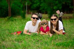Happy young family spending time outdoor on summer day. Happiness and harmony in family life. Family fun outside stock image