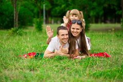 Happy young family spending time outdoor on summer day. Happiness and harmony in family life. Family fun outside stock images