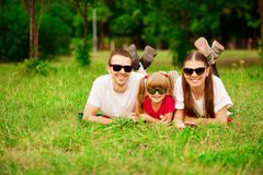 Happy young family spending time outdoor on summer day. Happiness and harmony in family life. Family fun outside stock photo