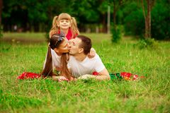 Happy young family spending time outdoor on summer day. Happiness and harmony in family life. Family fun outside royalty free stock photography
