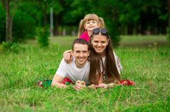 Happy young family spending time outdoor on summer day. Happiness and harmony in family life. Family fun outside stock photography