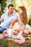 Happy young family spending time outdoor on a summer day, picnic. Happy young caucasian family spending time outdoor on a summer day, picnic in the park. Set royalty free stock images