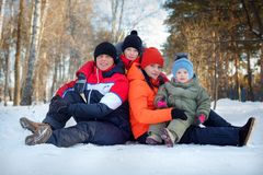 Family spending time outdoor in winter. Happy young family spending time outdoor in winter stock photos