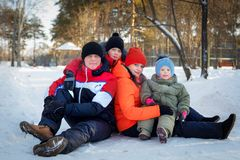 Family spending time outdoor in winter. Happy young family spending time outdoor in winter royalty free stock image