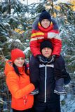 Family spending time outdoor in winter. Happy young family spending time outdoor in winter royalty free stock photo