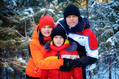 Family spending time outdoor in winter. Happy young family spending time outdoor in winter royalty free stock photos