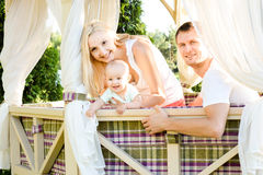 Happy young family spending time outdoors on a summer day. Royalty Free Stock Photo