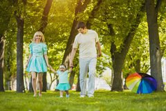 Happy young family spending time on a summer day. Young family spending time outdoor on a summer day stock photography