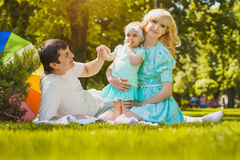 Happy young family spending time on a summer day Royalty Free Stock Images