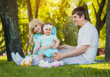 Happy young family spending time on a summer day. Young family spending time outdoor on a summer day royalty free stock image