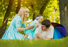 Happy young family spending time on a summer day Stock Image