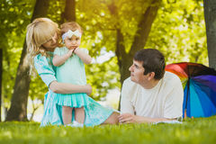 Happy young family spending time on a summer day Stock Photography