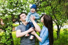 Happy young family spending time together Stock Images