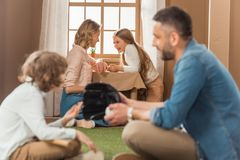 Happy young family spending time together. At toy house stock images