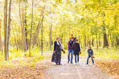 Happy young family spending time together outside in autumn nature. Royalty Free Stock Photo