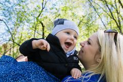 Happy young family spending time together outside in green nature.  royalty free stock image