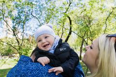 Happy young family spending time together outside in green nature.  royalty free stock photos