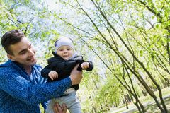 Happy young family spending time together outside in green nature.  royalty free stock images