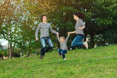 Happy young family spending time together in park. Happy young family spending time together in a park stock photo