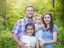 Happy young family in the spring forest Royalty Free Stock Photos