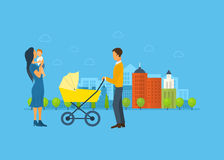 Happy young family with stroller and a baby, walk Stock Photography
