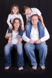 Happy young family - studio photo Royalty Free Stock Photo
