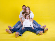 Happy young family - studio photo Royalty Free Stock Photography