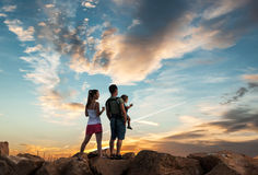 Happy young family on sunset royalty free stock photography