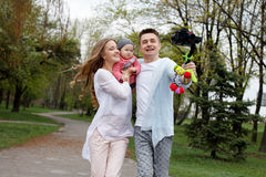 Happy young family taking video selfies with her camera on the gimbal steadycam. Happy young family taking selfies with her camera on the gimbal steadycam Stock Image