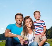 Happy young family stock images