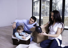Happy young family in their new apartment Stock Photo