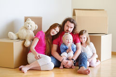 Happy young family in their new home Stock Images