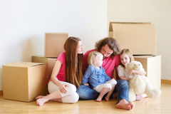 Happy young family in their new home Royalty Free Stock Image