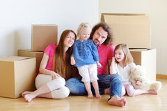 Happy young family in their new home Stock Image