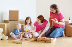 Happy young family in their new home Royalty Free Stock Photography