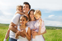 Happy young family with three children Royalty Free Stock Photo