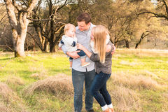 Happy Young Family Together Outdoors Royalty Free Stock Photo
