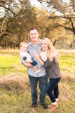 Happy Young Family Together Outdoors Royalty Free Stock Photos