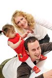 Happy young family together in studio Royalty Free Stock Images