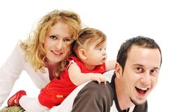 Happy young family together in studio stock photography