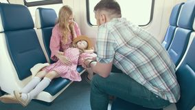 Happy young family traveling together - talking in the train and look out the window stock video footage