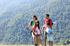 Happy young family on a trekking day Royalty Free Stock Image