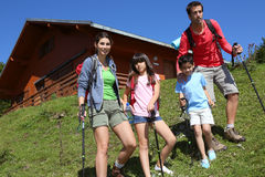 Happy young family trekking in mountains Royalty Free Stock Photo