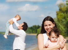 Happy young family with two children Stock Image