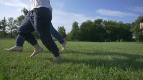 Happy young family with two children running on summer field.  stock video footage