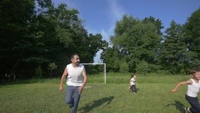 Happy Young Family with two children running on summer field. Slow motion.  stock video